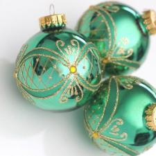 Green holiday ornaments. Photo Courtesy of Christmas Stock Images