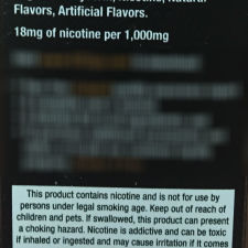 Ingredients and warning on the back label of an e-cigarette package
